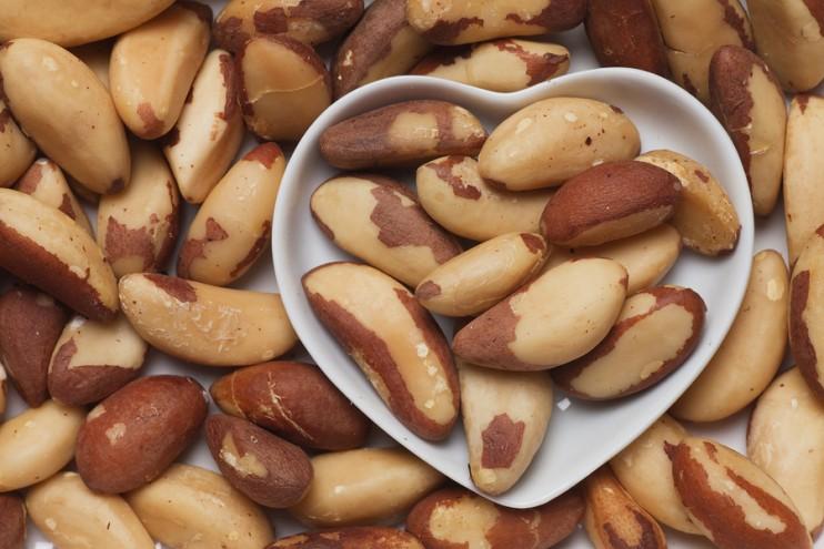 Brazil nut, healthy food ingredient in heart shaped tray